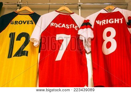 LONDON, ENGLAND - MAY 04, 2012 : Inside the official store of Arsenal Football Club with Perry Groves, David Rocastle and Ian Wright Jersey hang on a bar