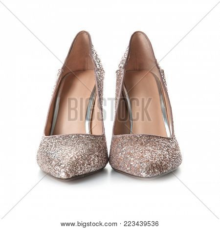 Beautiful high heeled shoes on white background