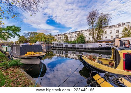 LONDON, UNITED KINGDOM - OCTOBER 30: Boats in the famous Little Venice along the Regents Canal waterway on October 30, 2017 in London