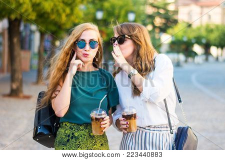 Happy gossip girls walking around the city