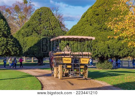 LONDON, UNITED KINGDOM - OCTOBER 28: Traditional horse drawn carriage in the gardens of Hampton Court Palace on October 28, 2017 in London