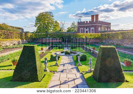 LONDON, UNITED KINGDOM - OCTOBER 28: Traditional Royal Gardens of the Hampton Court Palace a famous historic Palace in Richmond on October 28, 2017 in London
