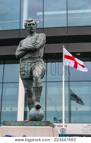 LONDON, ENGLAND - MAY 05, 2012 :  Bobby Moore statue outside Wembley Stadium. An English legendary footballer, regarded as one of the best defenders. He was an England captain who lead the team won World Cup 1966.
