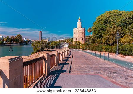 Dodecagonal military watchtower Golden Tower or Torre del Oro in the sunny day , Seville, Andalusia, Spain