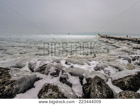 Frozen Winter Landscape. Great Lakes coast on the shores of Lake Michigan in a deep freeze at Holland State Park.