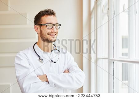 Competent doctor proud of his profession looking self-confident