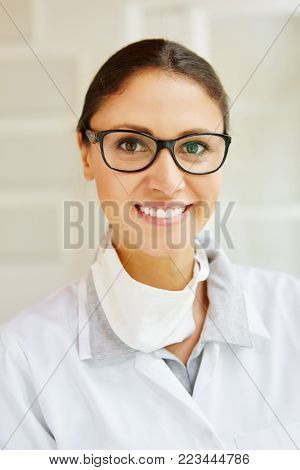 Competent doctor friendly smiling in office