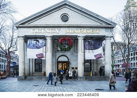 BOSTON, USA - NOVEMBER 26: Initially built as an indoor commercial pavilion, The Quincy Market was naturally expanded to a plaza surrounded by stores as seen on November 26, 2017 in Boston, MA, USA.