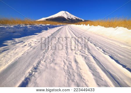 Mount Fuji on the snowy road of