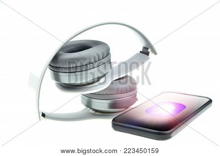 Wireless headphones with moblie phone isolated on a white background,  white headphone