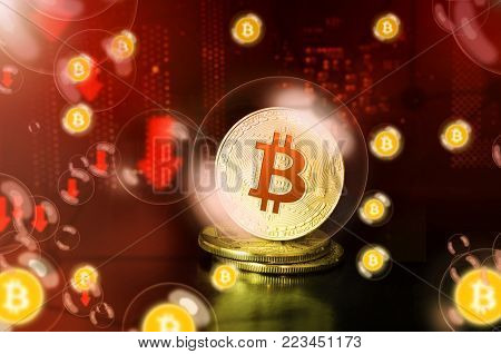 Bitcoin in a soap bubble on red background. Bitcoin price WARNING. Unstable concept. Collapse of the exchange rate