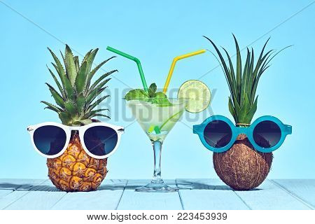 f6de12db6bc9 Two Hipster Fruits in Trendy Sunglasses, Cocktail on Beach. Tropical  Pineapple and Coconut.