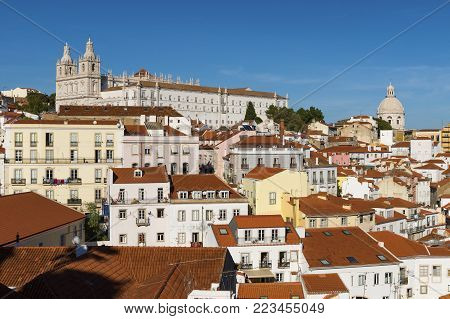 View of the Alfama neighborhood from the Portas do Sol viewpoint in Lisbon, Portugal; Concept for travel in Portugal, visit Lisbon and most beutiful places in Portugal