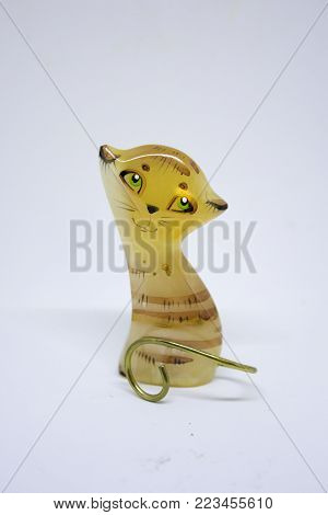 Yellow cat from glass on white background