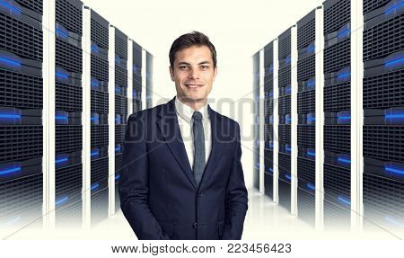 3d image of datacentre with lots of server and smiling man