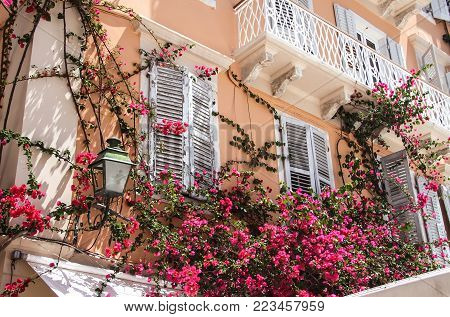 Beautiful balcony in the apartment building. Greece