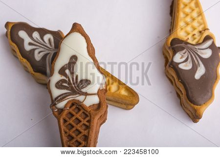 Cookies with colorful glaze. Three pieces. Sweets in the form of ice cream. Holiday for children. Delicious homemade biscuit.lezht on a white background