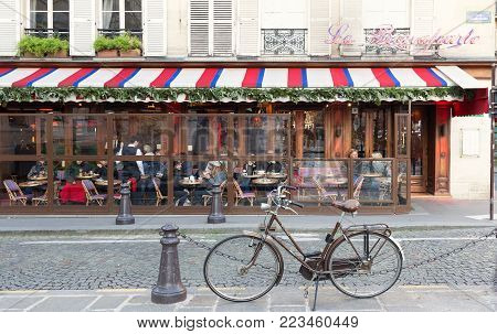 Paris, France-January 14, 2018 : Le Bonaparte is one of the finest traditional cafes of Saint-Germain des Pres. Its terrace offers breathtaking views of the abbey church.