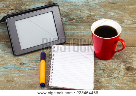 News Inscription On E-book Screen . E-book On Desk In Library. Alternative For Traditional Books