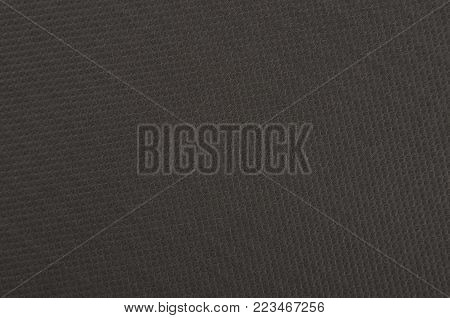 Embossed paper background, black color, close up