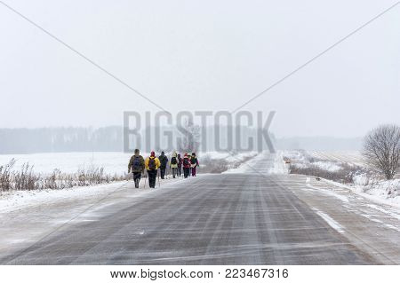 A Group Of Tourists Walking Along The Road In The Village Of Goritsy, Ivanovo Region, Russia.