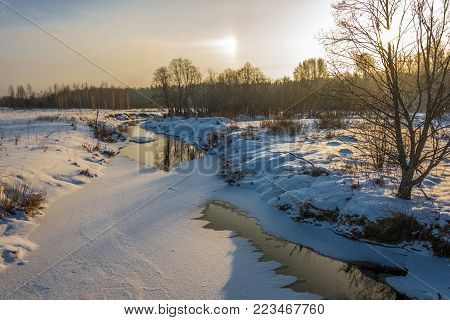 Landscape With A Small River On A Winter Day.