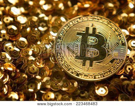 Golden Bitcoins,Bitcoin on Golden background - the new virtual money