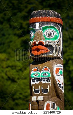 Totem pole in the forest, Quadra Island, Canada