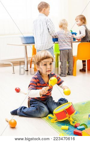 Kids  playing in the playroom. Children fantasize that they Musicians