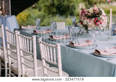 wedding decor on the table with cutlery and flowers