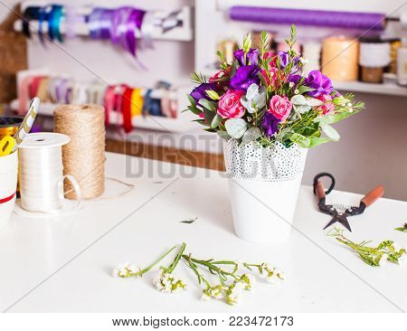 Flower market place. Different decoration for bouquets is on the table floristic store, ikebana