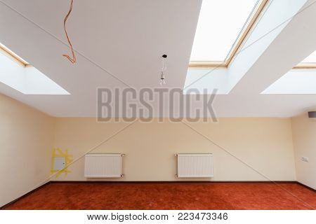 Interior of apartment  with mansard (garret)  and central heating during  upgrade  or  remodeling, renovation, extension, restoration, reconstruction and construction.