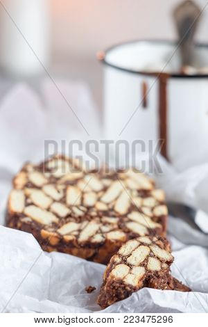 Pieces of chocolate cake from cookies and cocoa with marshmallow on bakery paper High key Still life food style Hugge scandinavian nordic