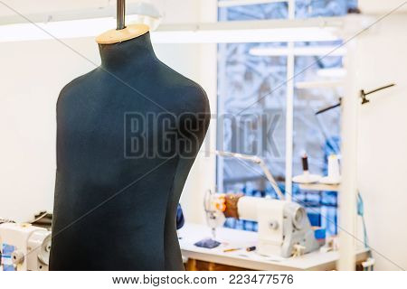 Close up male sew mannequin on talor working place. The concept of sewing production. Selective focus, space for text