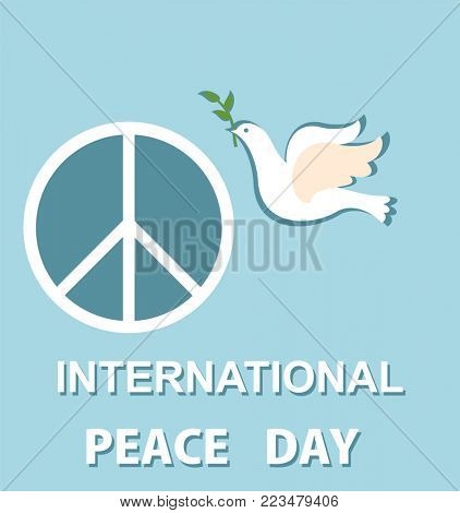 Pastel blue greeting card with paper cut out dove and peace symbol for International Peace day