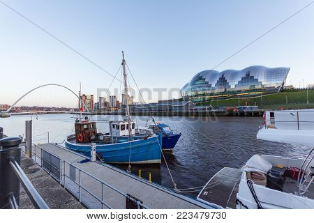 Newcastle Quayside With Gateshead Millenium Bridge And Boat In Sight