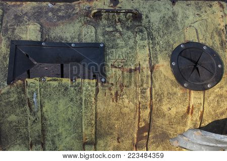 Grunge texture abstract background with a greenish color turning into a yellowish with a black rectangle and circle, a modern design trend of the decoration of the wall.