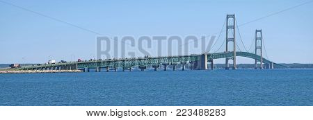 Spanning the Straits of Mackinac, which joins Lake Michigan and Lake Huron, the five-mile long Mackinac Bridge joins the upper peninsula of Michigan at St. Ignace to the lower peninsula of Michigan at Mackinaw City.  The bridge is sometimes called Mighty