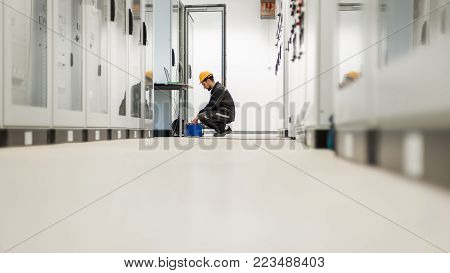 Maintenance Engineer Inspect System With Relay Test Set Equipment