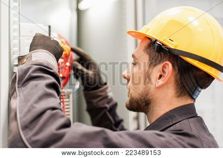 Electrician Engineer Tests Electrical Installations On Relay Protection System
