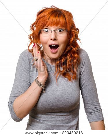 Concept of feelings tension astonishment adrenalin. Redhead Women with glasses.