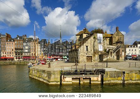 HONFLEUR, NORMANDY / FRANCE - MAY 23, 2013: Old village and harbor entrance. Calvados region. Europe.