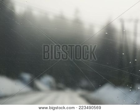 A dirty window with scratches for a grungy and tough look.