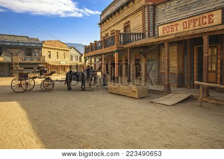 TABERNAS DESERT, ALMERIA ANDALUSIA / SPAIN - SEPTEMBER 18, 2011: Post office movie location set for spaghetti western in desert, horse drawn carriage. Protected wilderness area. Europe