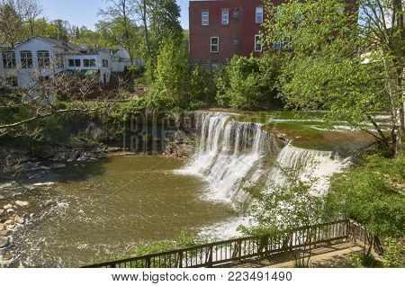Chagrin Falls, Ohio river falls with building backdrop