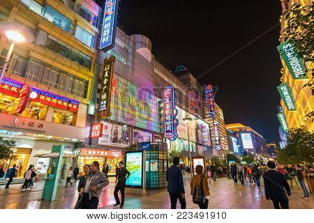 Shanghai, China - Nov 8, 2017: People visiting the Nanjing Road shopping street in Shanghai. It is a popular tourist attraction featuring modern shopping malls, historic shops and restaurants.