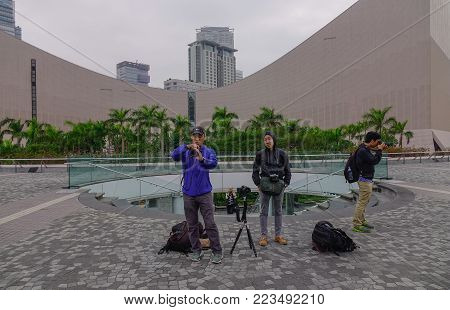 Hong Kong - Mar 29, 2017. People Relaxing On The Square In Hong Kong. In 2014, Hong Kong Was The Ele
