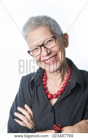 Portrait of a charming senior lady on white background