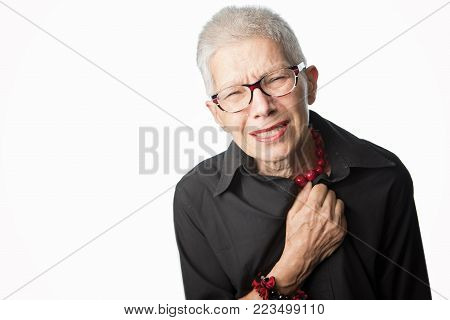 Senior old lady experiencing strong pain in her chest