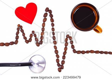 Electrocardiogram line of roasted coffee grains, red heart and medical stethoscope, ecg heart rhythm, medicine and health care concept